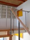 ロフトには間仕切り用の移動家具を設え将来の子供部屋に対応している